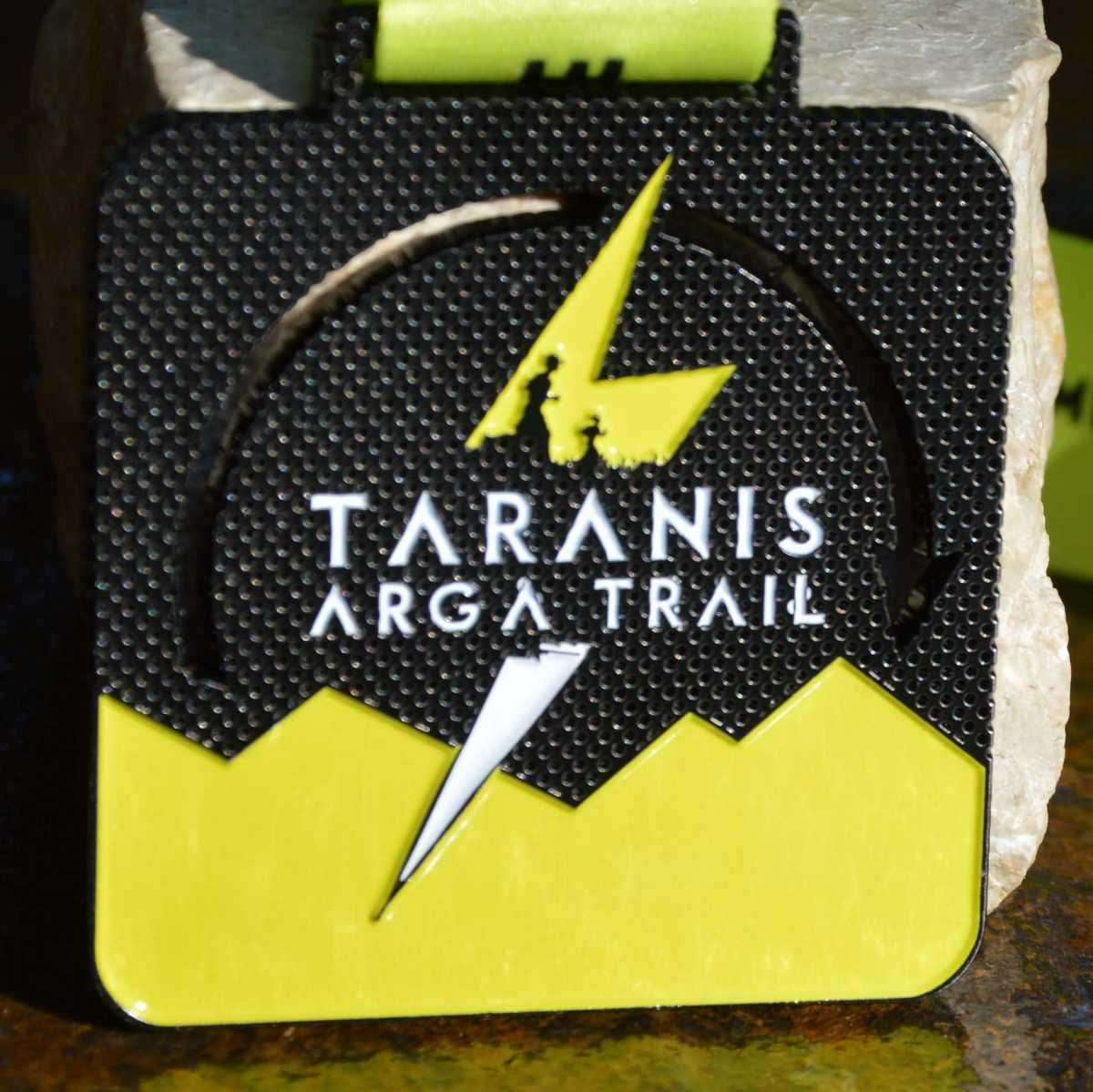 Black and yellow square medal made for the Taranis Arga Trail